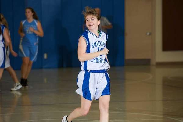 Smithtown Christian guard Gennifer Vandeventer (13) reacts after