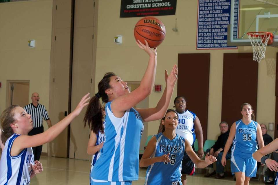 Ross senior Yvonne Zhang (45) attempts a shot