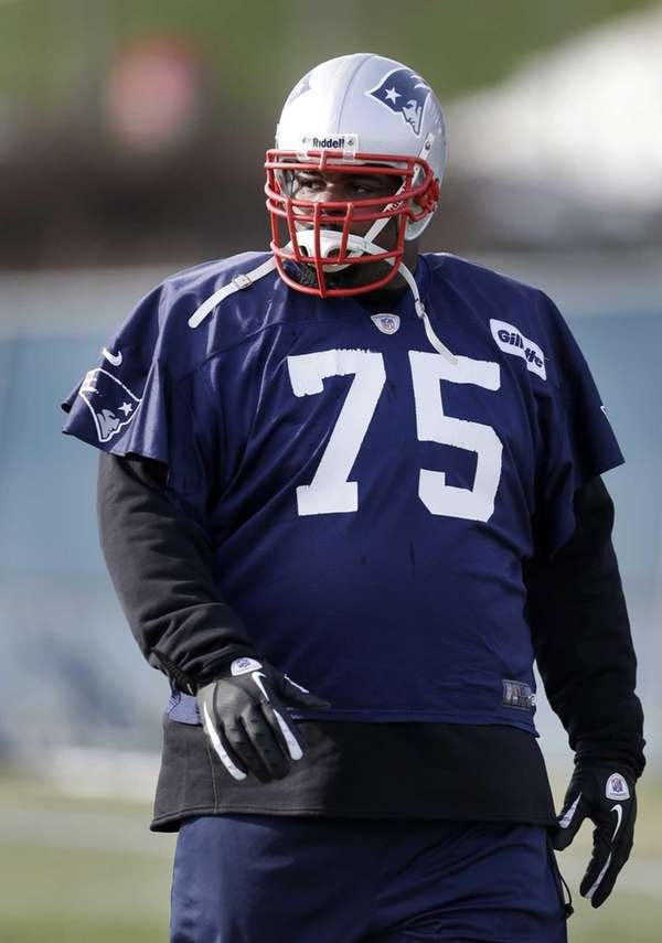 New England Patriots defensive tackle Vince Wilfork walks