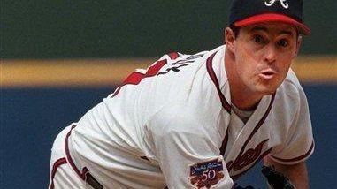 Atlanta Braves pitcher Greg Maddux throws to the