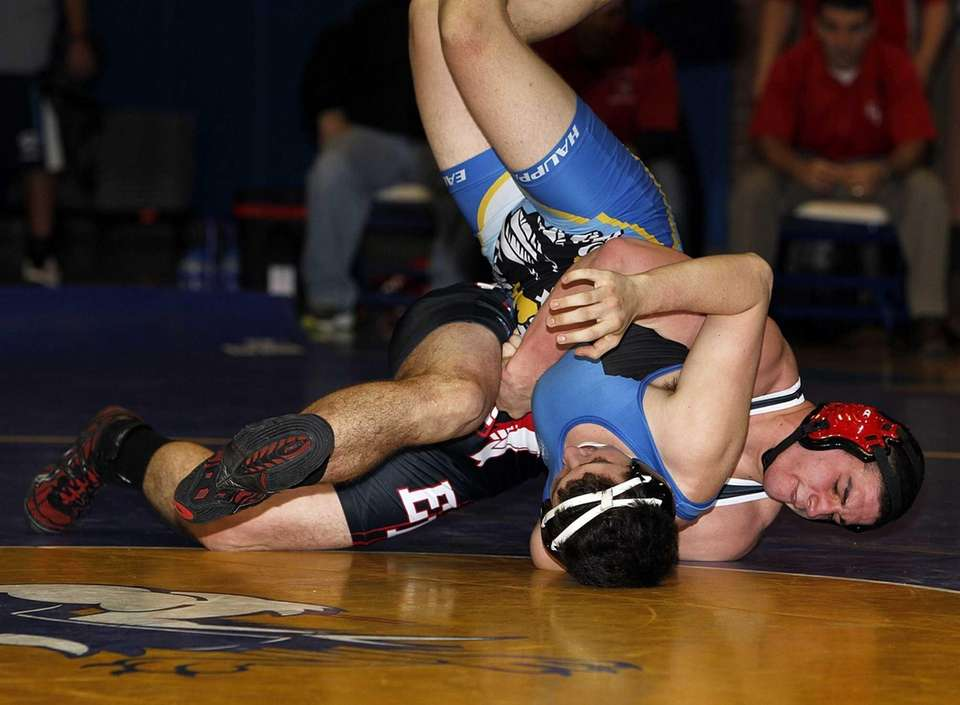 East Islip's Chris Chambers controls Hauppauge's Dillon Brophy