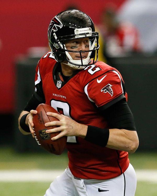 Atlanta Falcons quarterback Matt Ryan rolls out of