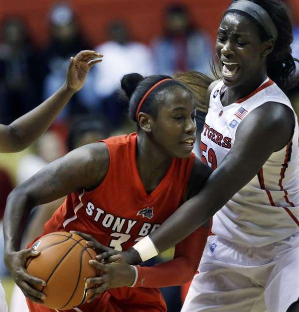 Rutgers' Chelsey Lee, right, tries to block the