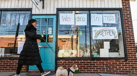 Business owner Michelle Burton walks her dog Teddy