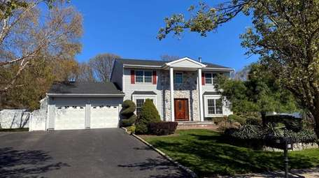 Priced at $920,000, this five-bedroom, 3½-bathroom Colonial on
