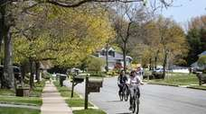 Bicyclists roll down the Country Woods section of