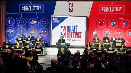 NBA deputy commissioner Mark Tatum gets ready to