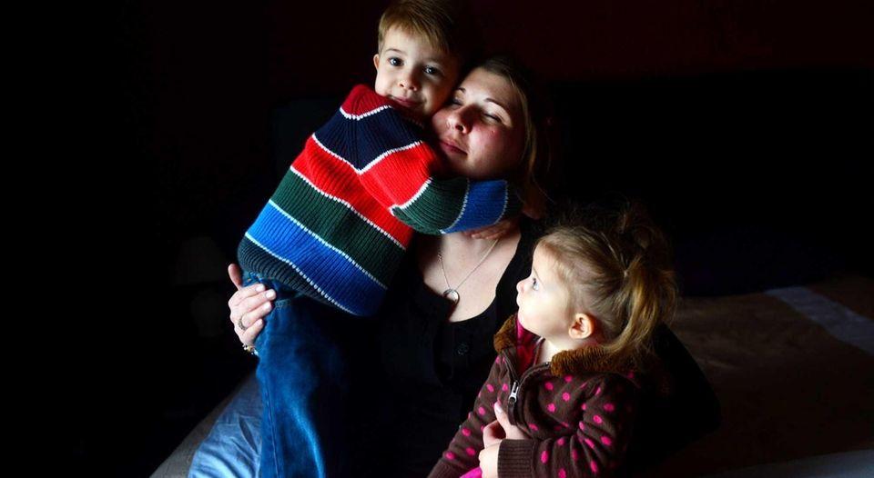 Katie Beers with her two children, Logan, 3,