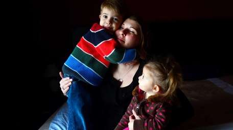 Katie Beers with her two children, Logan, 3,