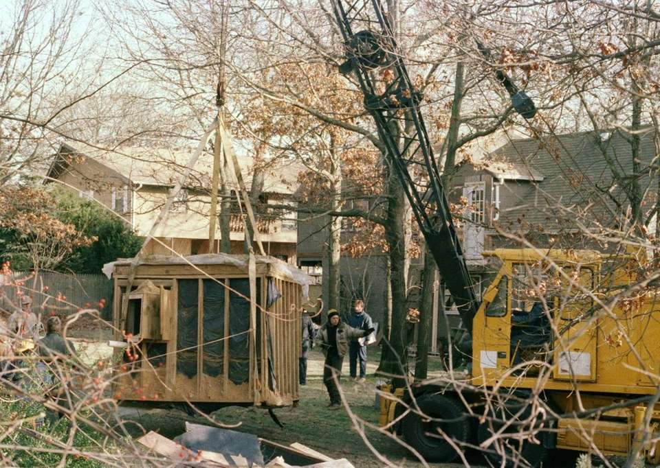 A 30-foot-high crane raises the bunker out of
