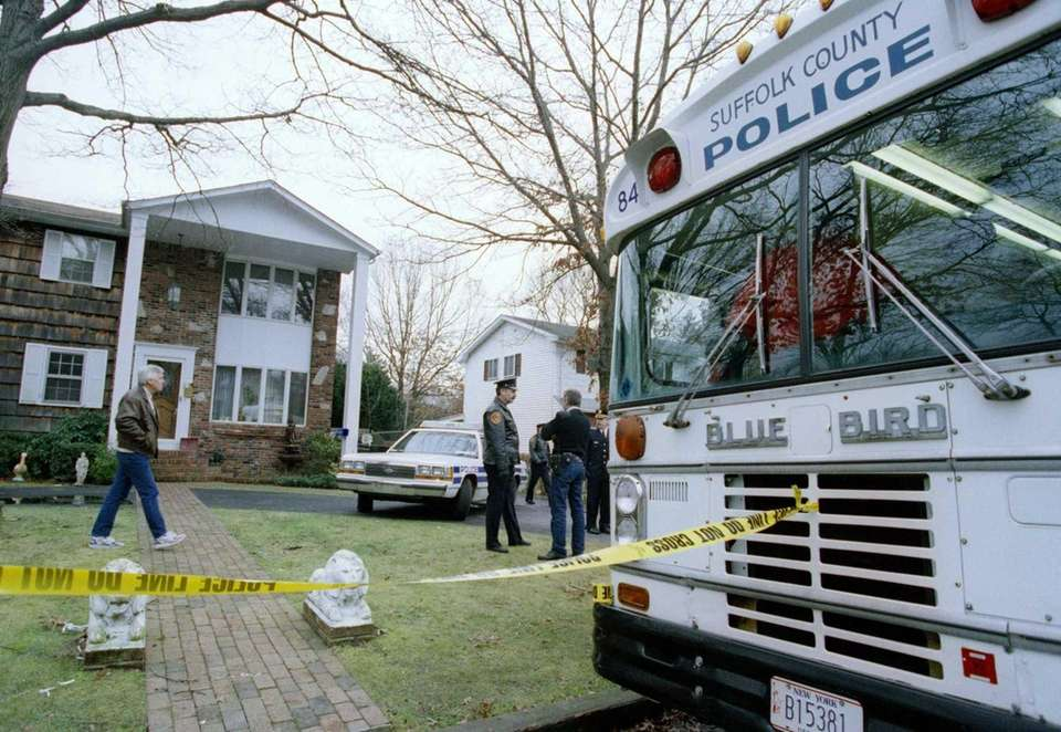 Suffolk County Police continue their investigation at the