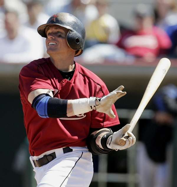 Craig Biggio watches the flight of a hit