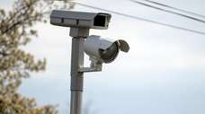 A red-light camera at Indian Head Rd. and