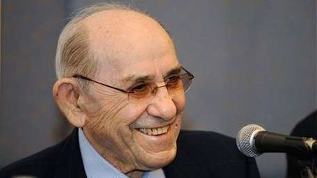 Yankees Hall of Famer Yogi Berra smiles during