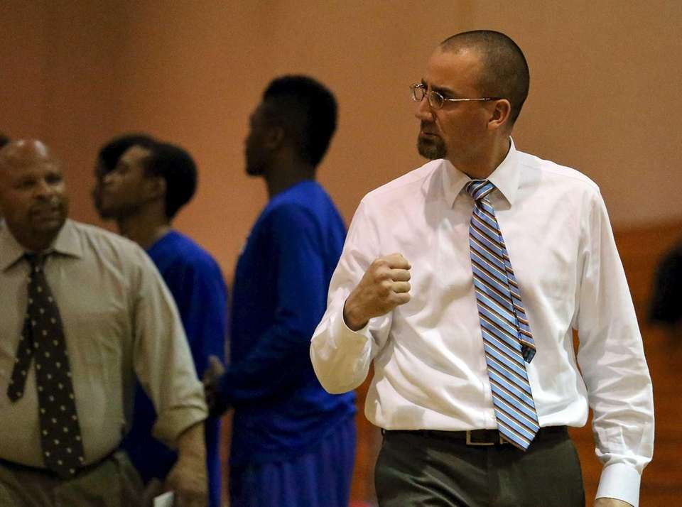 Riverhead coach John Rossetti reacts as his team