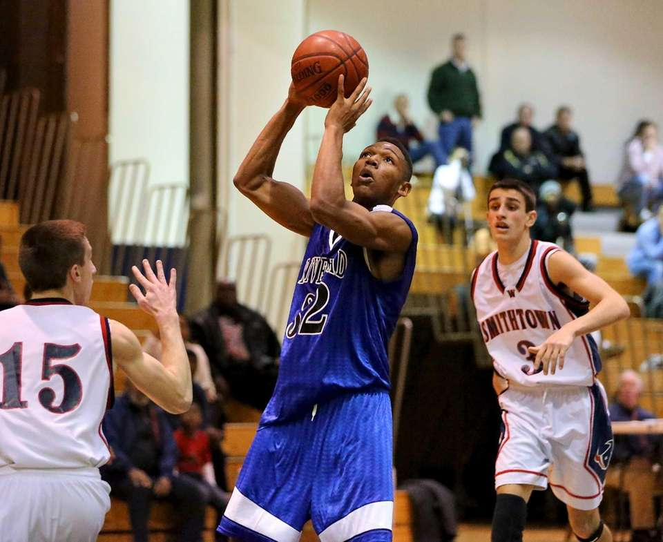 Riverhead's Brandon Tolliver takes a shot over Smithtown