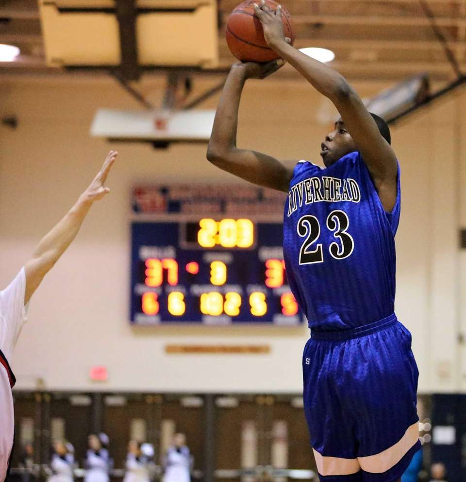 Riverhead's Markim Austin puts up a 3-pointer during
