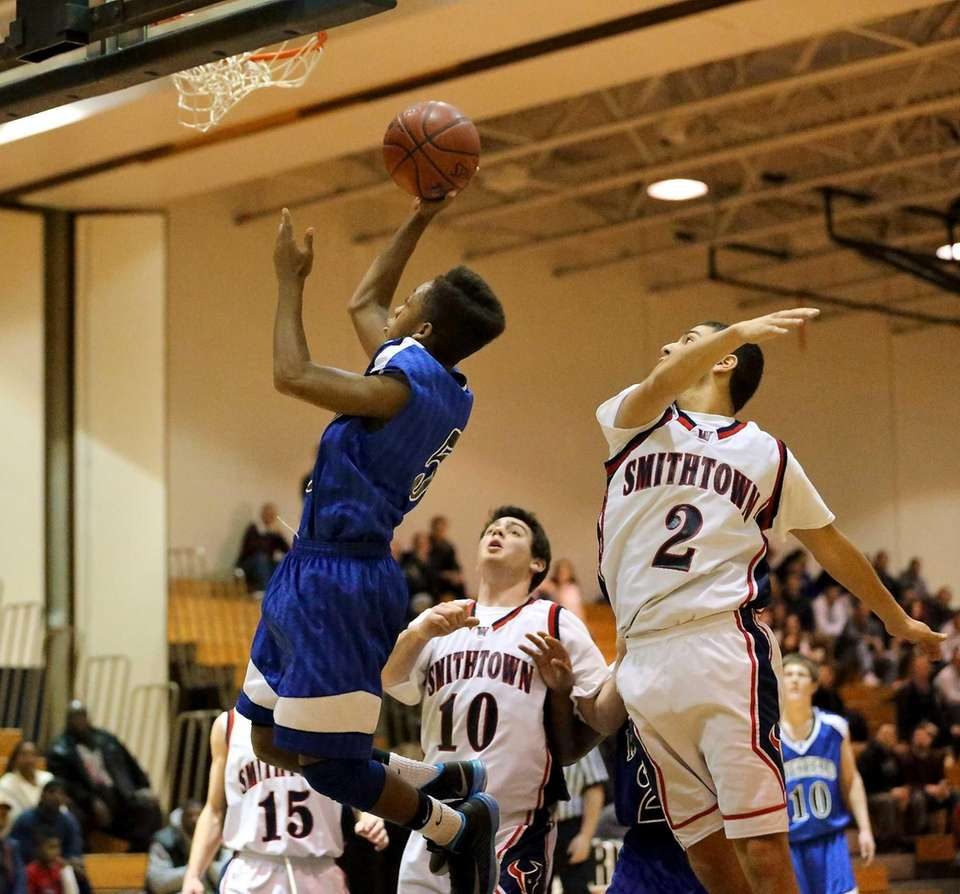 Riverhead's Deon Shorter goes baseline for the layup