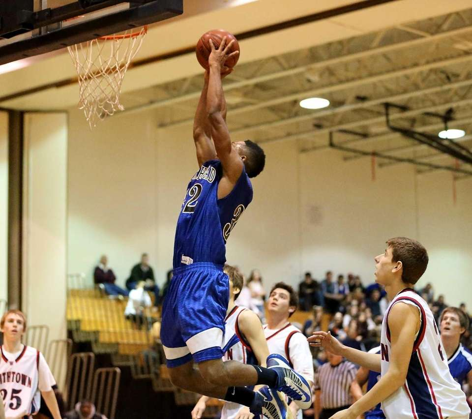 Riverhead's Brandon Tolliver goes up for the dunk