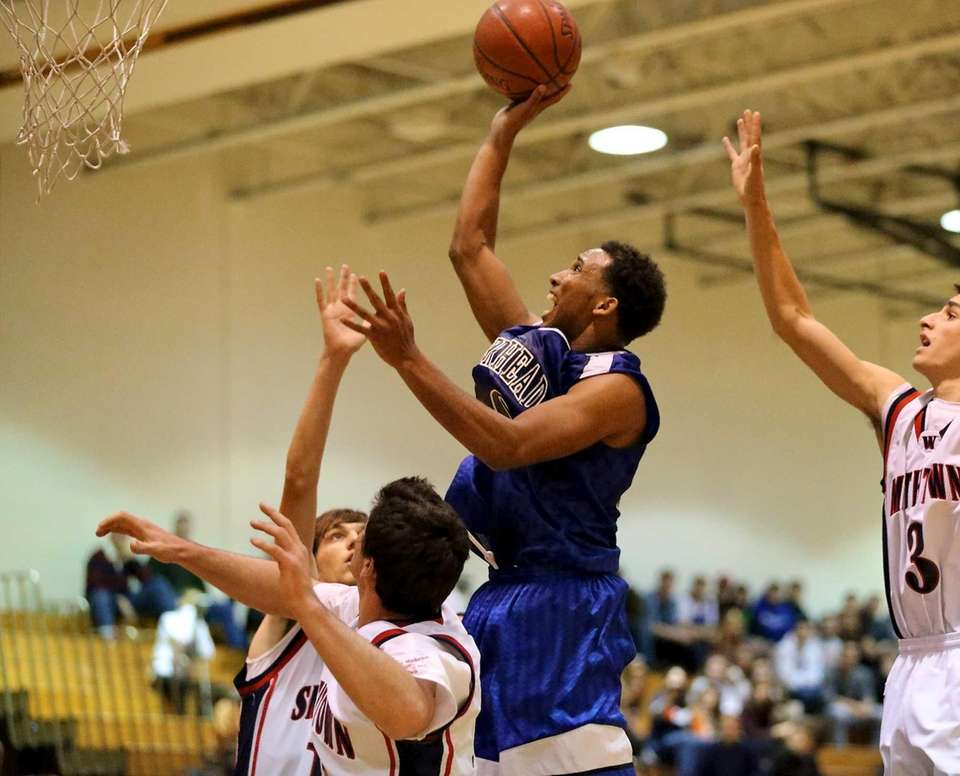 Riverhead's Jeremiah Cheatom takes a shot over three