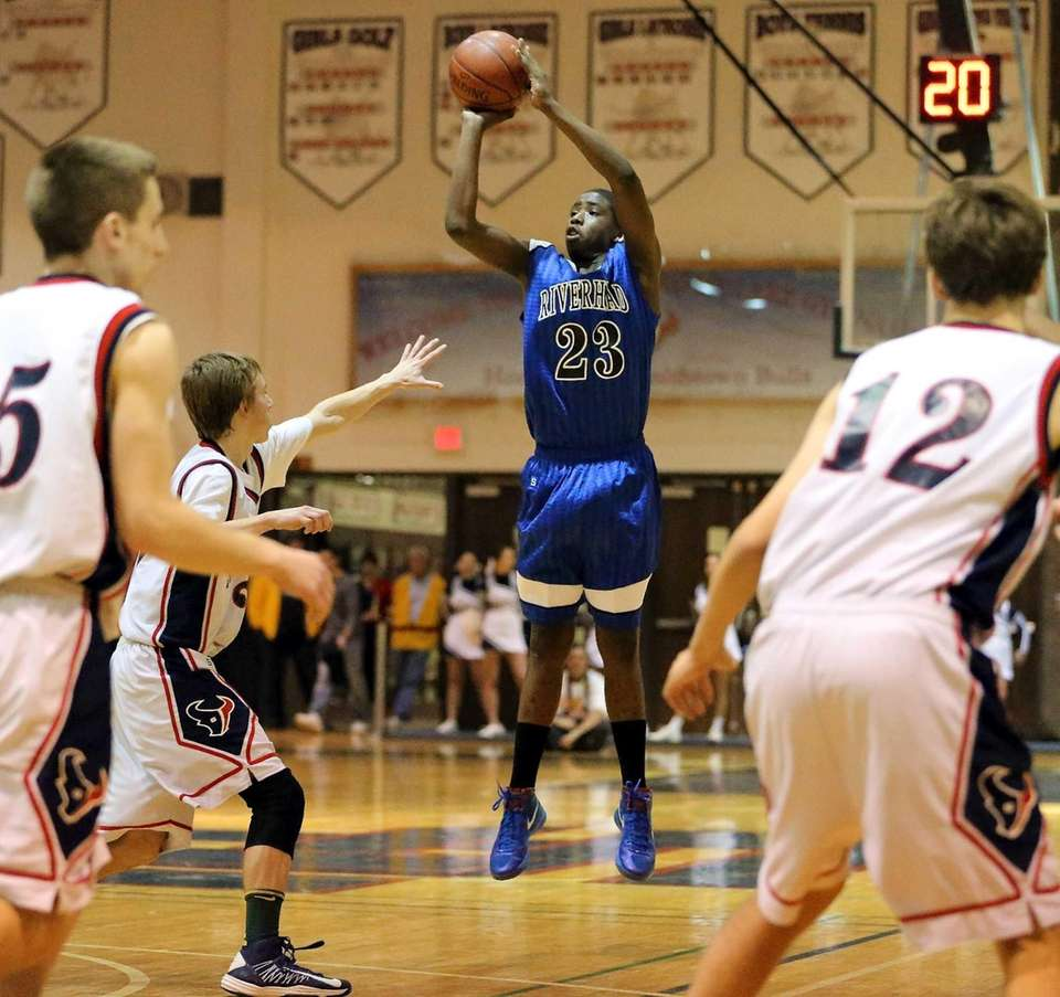 Riverhead's Markim Austin makes a 3-pointer during a