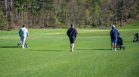 Sayville High School golf coach Sean McLaughlin, left,