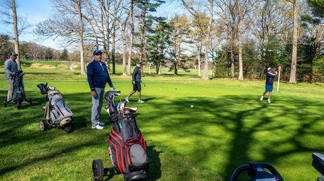 Sayville High School golf coach Sean McLaughlin, far