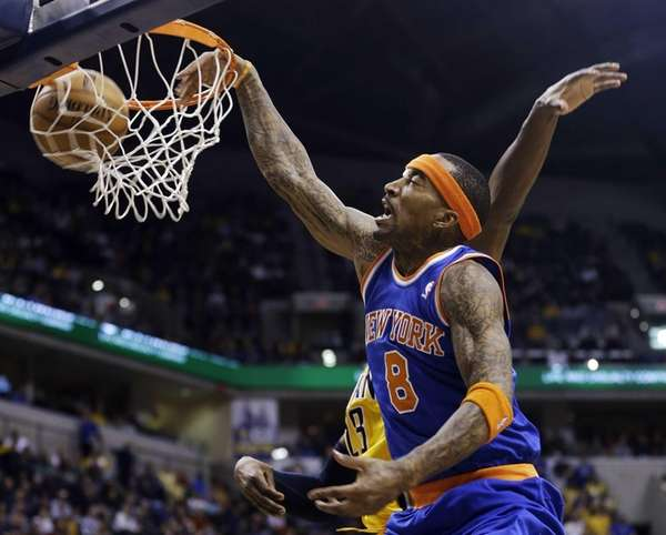 J.R. Smith (8) dunks over the Indiana Pacers'