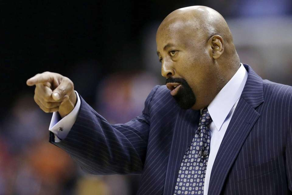Mike Woodson gives directions to his team during