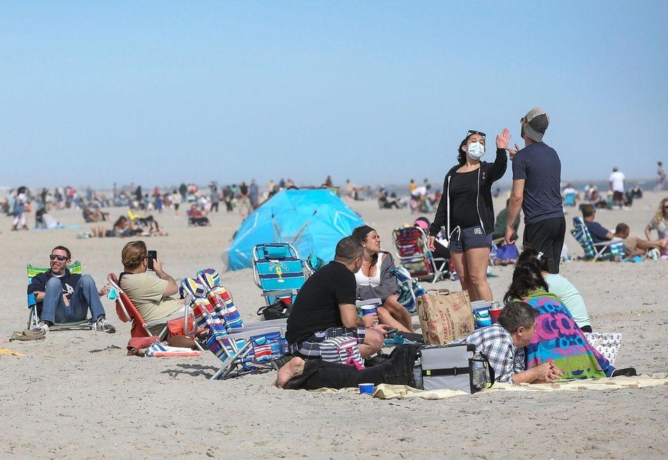Beachgoers gather on the sand at Long Beach