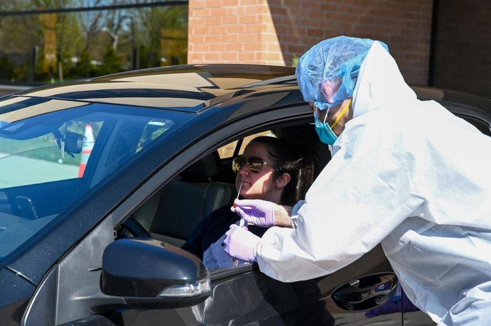 Lindsey David, A Medford EMT, has a swab