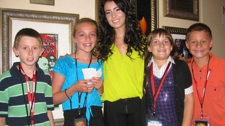 Singer Tiffany Giardina with Kidsday reporters (l) Ryan