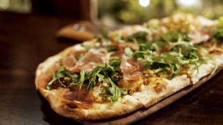 Lula Trattoria Parma thin-crust pizza is topped with
