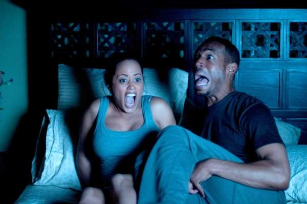 Marlon Wayans and Essence Atkins in quot;A Haunted