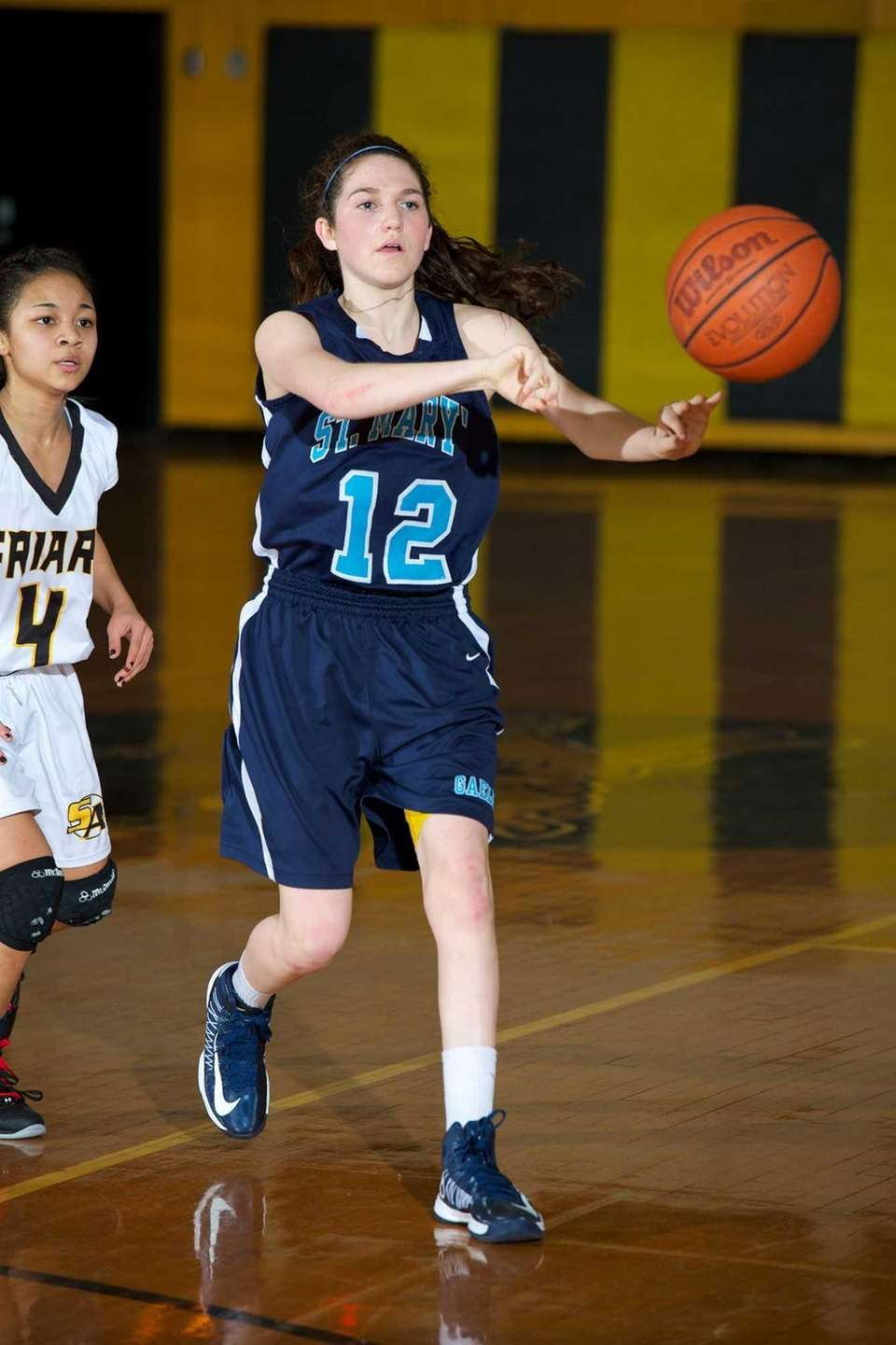 St. Mary's guard Mykayla Hernandez (12) passes the