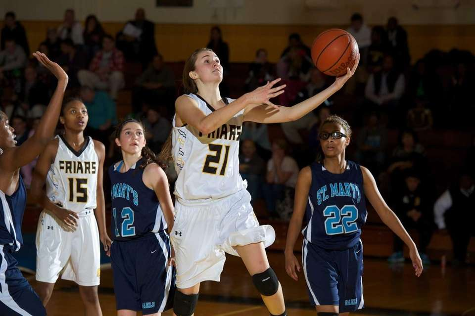 St. Anthony's guard Johanna Impellizeri (21) lays the