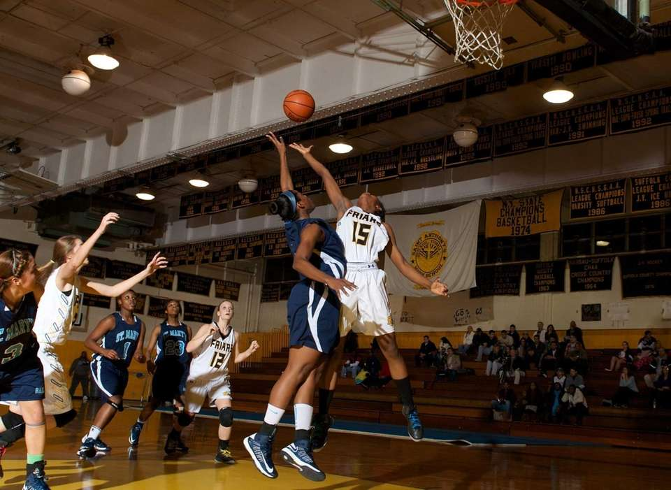 St. Anthony's forward Kalifa Davy (15) goes up