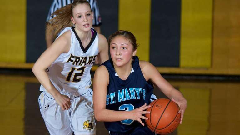 St. Mary's guard Mei-Lyn Bautista (3) dribbes the