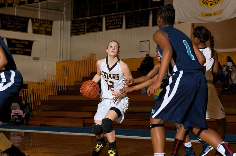 St. Anthony's guard Rebecca Musgrove (12) looks to