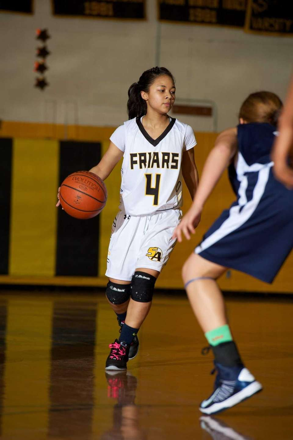 St. Anthony's guard Tyla Parham (4) looks for