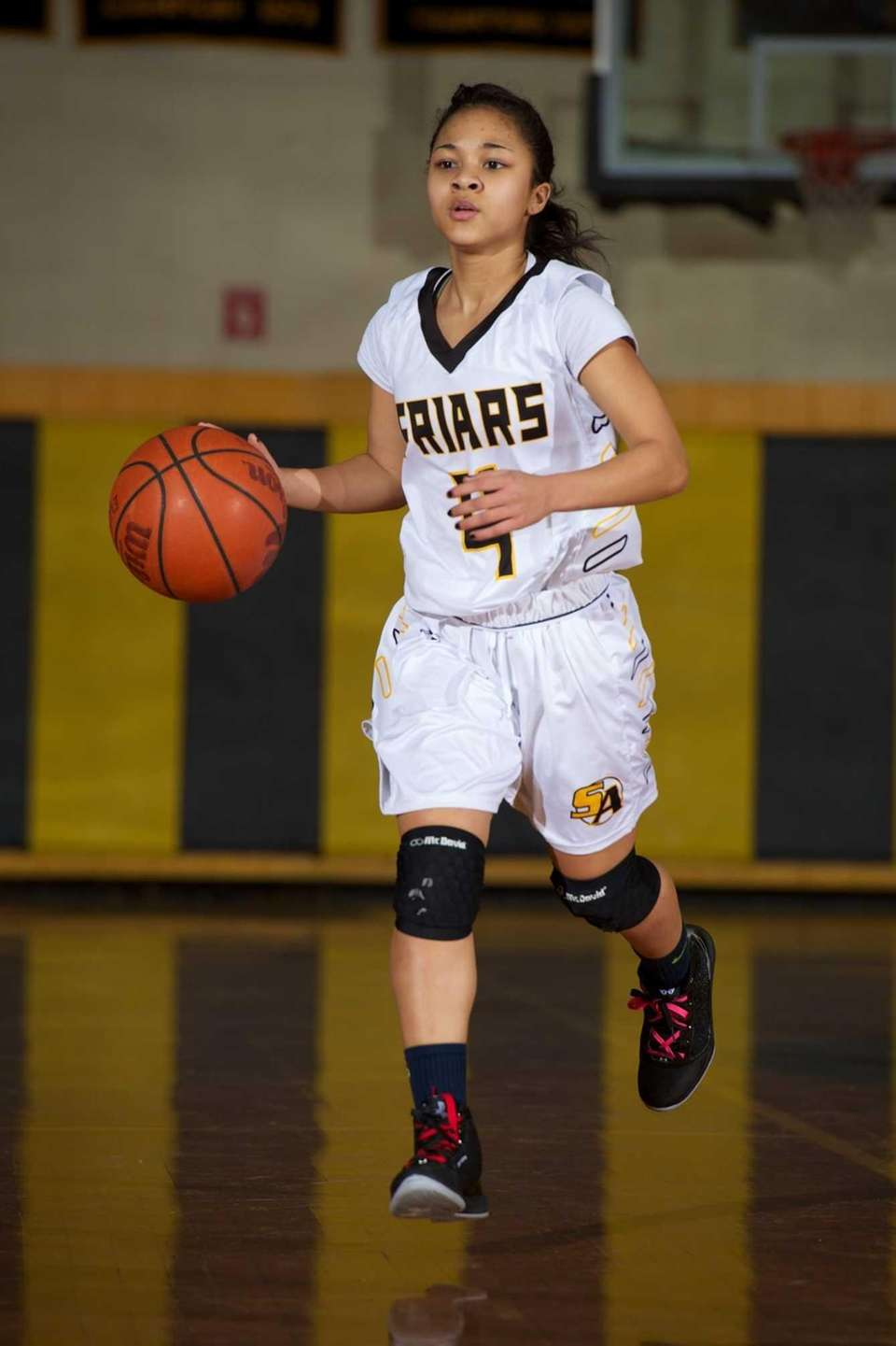 St. Anthony's guard Tyla Parham (4) dribbles the
