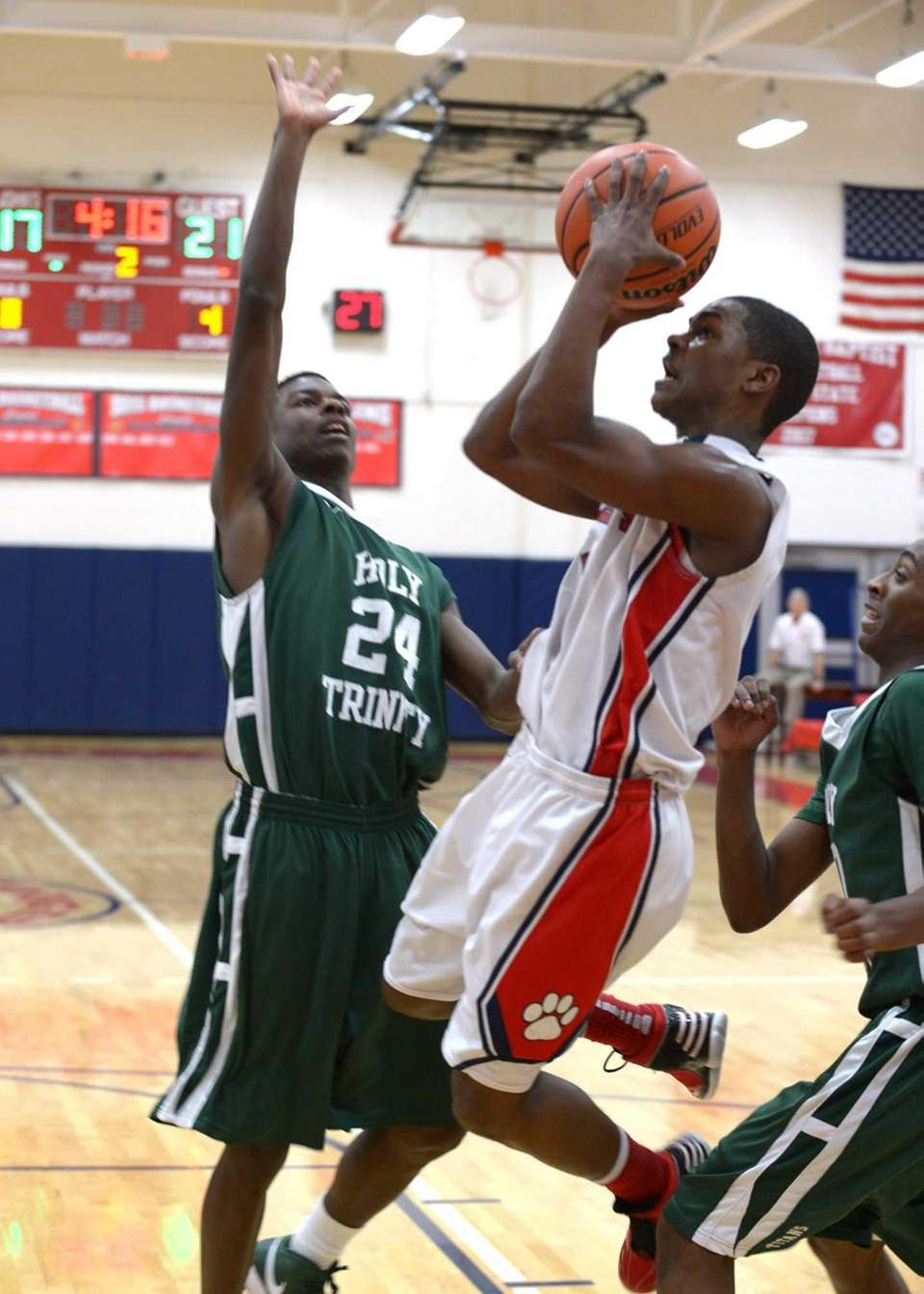 St. John the Baptist's Travon Ginyard drives for