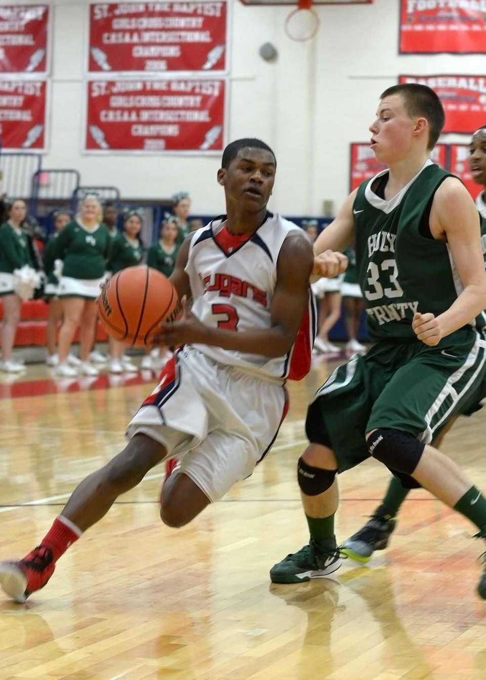 St. John's Travon Ginyard drives past Holy Trinity's