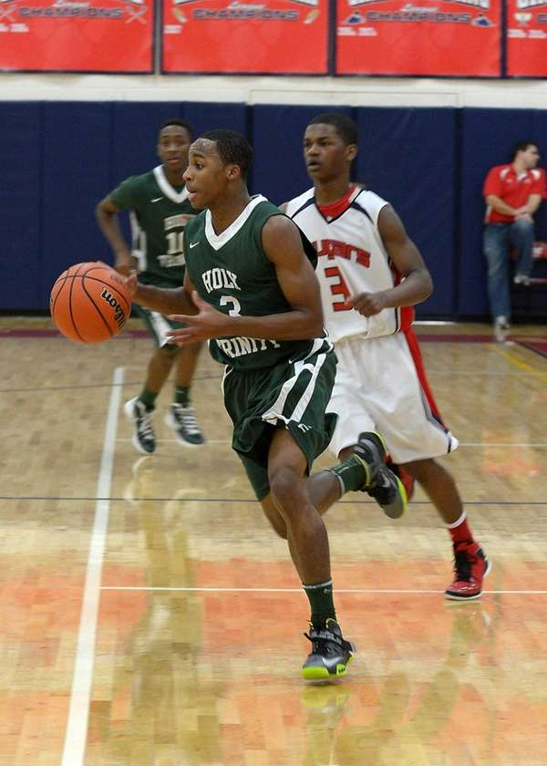 Holy Trinity's Damon Coleman drives to the basket