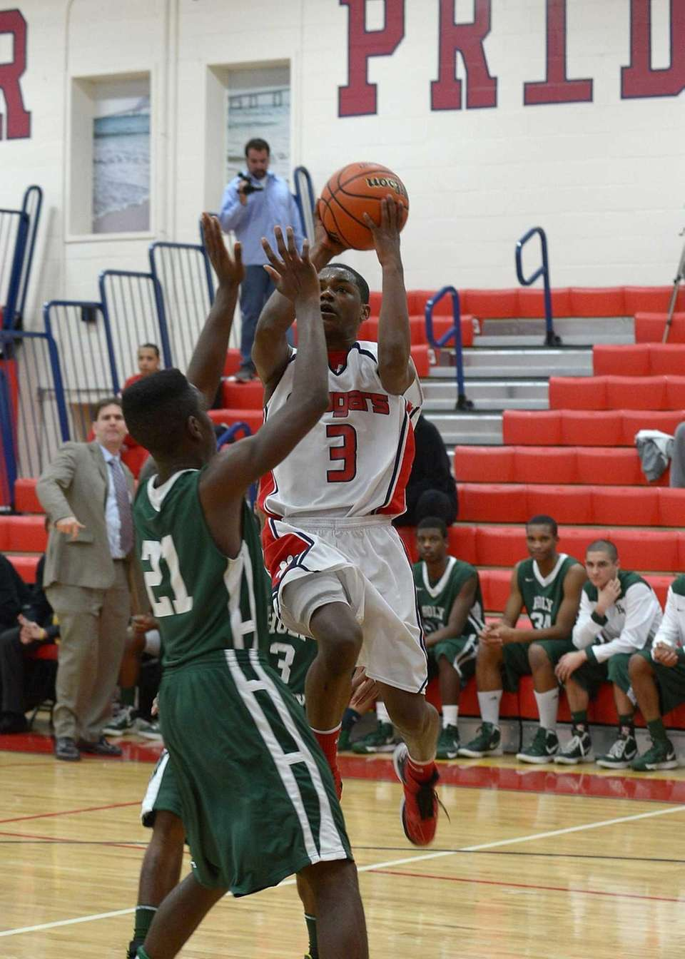 St. John the Baptist's Tavon Ginyard goes up