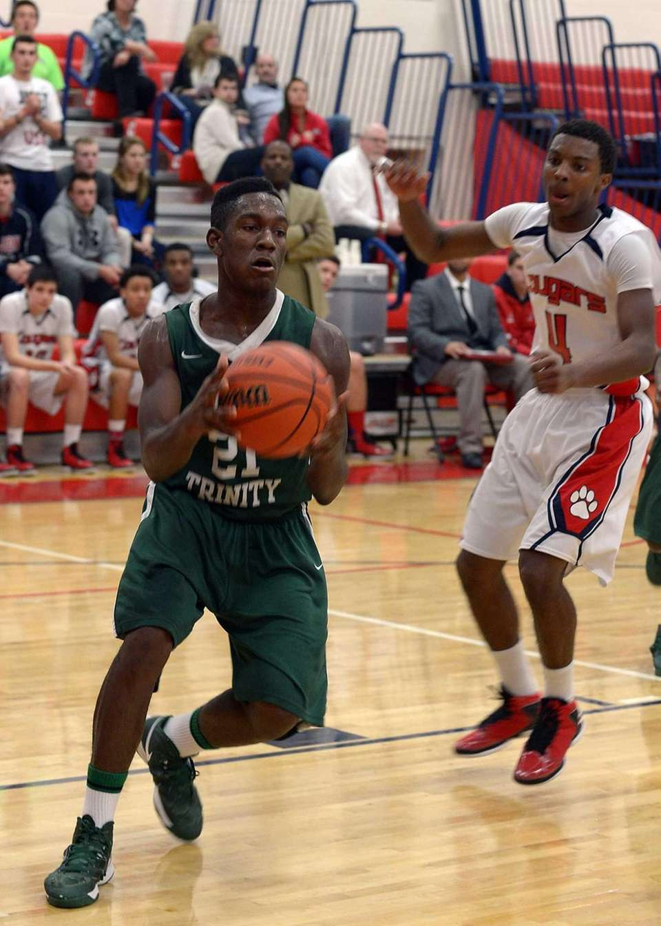 Holy Trinity's Isaish Rowe-Ukey drives to the basket