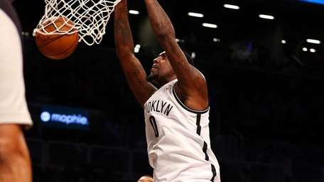 Andray Blatche dunks the ball in the first