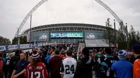 Fans arrive at Wembley Stadium before an NFL