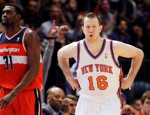 Steve Novak celebrates after making a three-pointer during