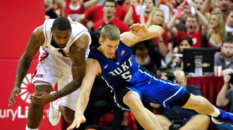 Mason Plumlee of the Duke Blue Devils battles